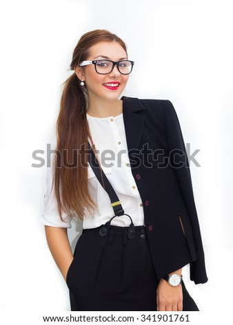Portrait of happy smiling young business woman. young woman wearing black suit,white blouse and suspenders.With long hair and red lips.business woman standing in full body.Smile,positive emotions. - stock photo