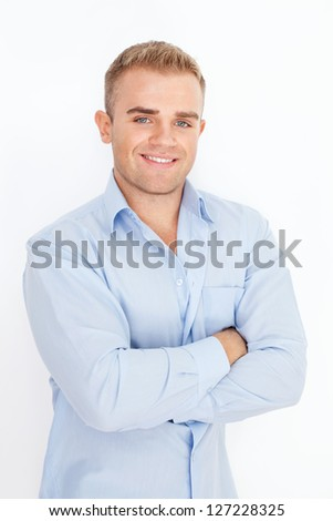 Portrait of happy smiling young businessman on white background