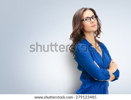 Portrait of happy smiling young businesswoman in glasses, with blank copyspace area for slogan or text - stock photo
