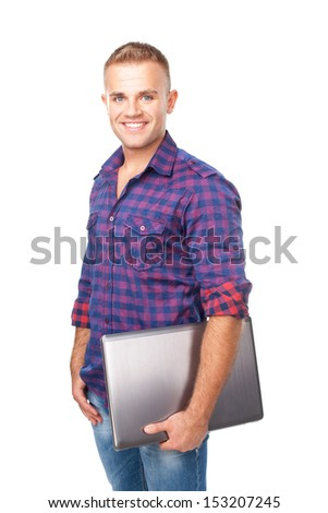 Portrait of happy smiling young man holding laptop isolated on white background