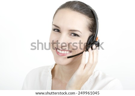 Portrait of happy smiling young support phone operator in headset at office - stock photo