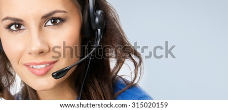 Portrait of happy smiling young support phone operator or businesswomen in headset, posing at studio