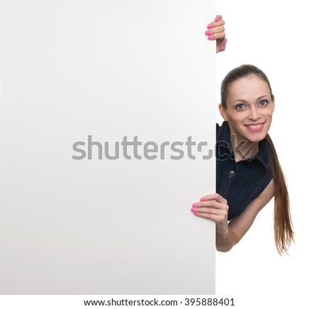 Portrait of happy smiling young woman showing empty blank signboard with copyspace area for text, isolated against white background - stock photo