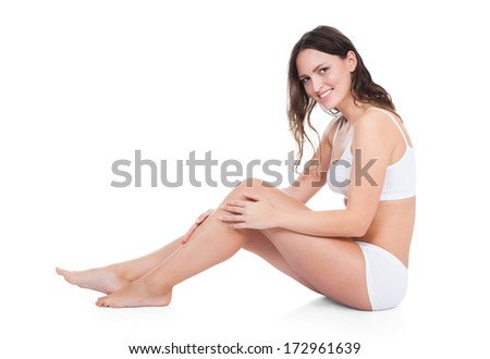 Portrait Of Happy Smiling Young Woman Sitting On White Background - stock photo