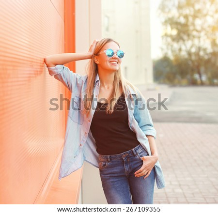 Portrait of happy smiling young woman wearing a casual clothes having fun and enjoying outdoors in sunny day - stock photo