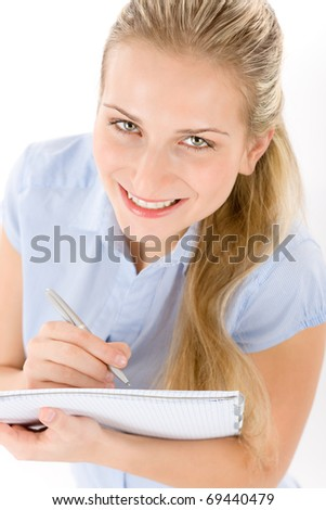 Portrait of happy student woman write notes on white background
