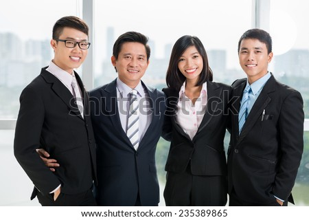 Portrait of happy successful business team - stock photo