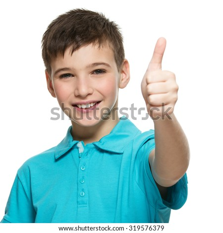 Portrait of happy teen boy showing thumbs up gesture, isolated over white background