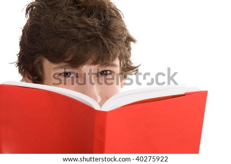 Portrait of happy teenage boy reading book isolated on white background