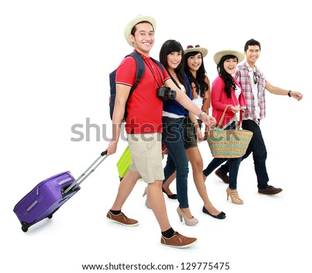 portrait of happy teenager tourist walking and smile viewed from the side - stock photo