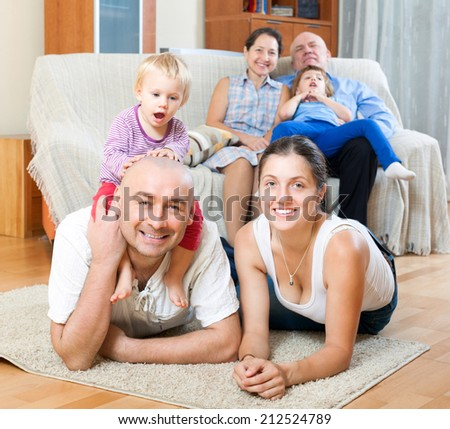Portrait of happy three generations family with little children - stock photo