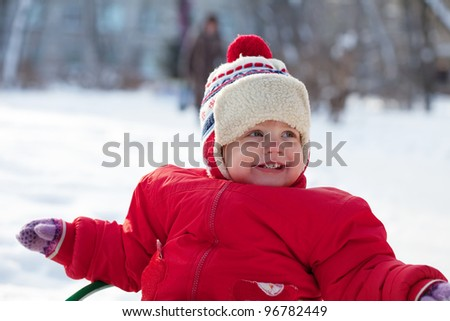 Portrait of happy toddler  in winter park - stock photo