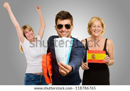 Portrait Of Happy Tourist Family Isolated On Gray Background - stock photo