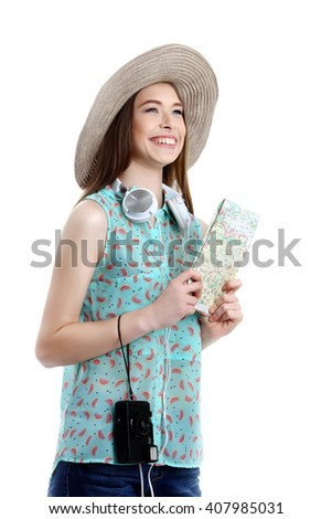 Portrait of happy tourist woman holding map on holiday on white background - stock photo