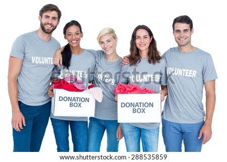 Portrait of happy volunteers friends holding donation boxes