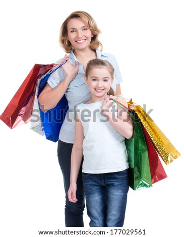 Portrait of happy  white mother and young daughter with shopping bags- isolated. Happy family people concept.