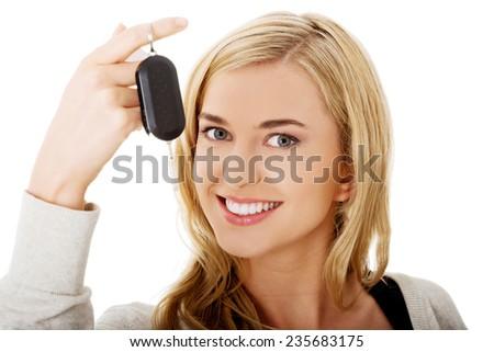 Portrait of happy woman holding a car key. - stock photo