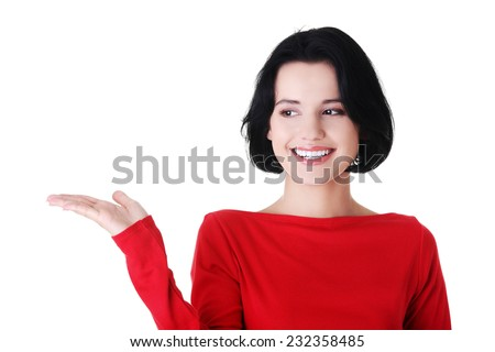 Portrait of happy woman holding a copyspace. - stock photo