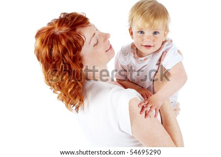 Portrait of happy woman holding her small daughter