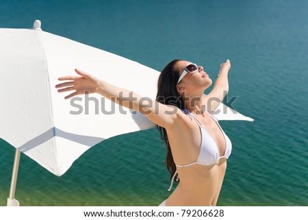 Portrait of happy woman in white bikini bra on sunny day - stock photo