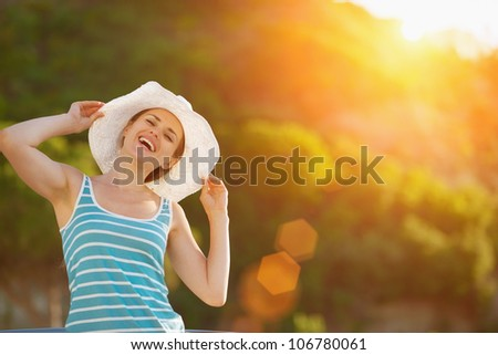 Portrait of happy woman on vacation - stock photo