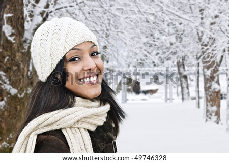 Portrait of happy woman outdoors in winter - stock photo