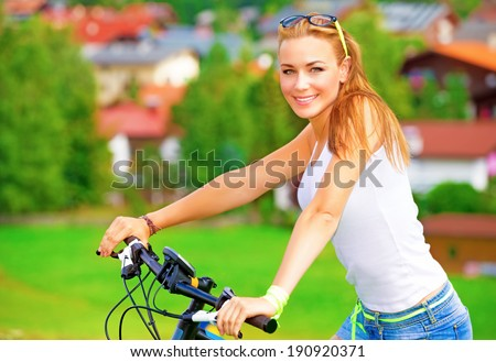 Portrait of happy woman resting in countryside, enjoying European tour on bicycle, extreme sport, happy summer holidays concept - stock photo