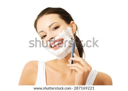 Portrait of happy woman shaving beard. - stock photo
