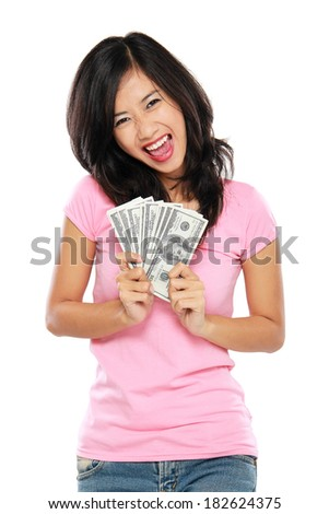 portrait of happy woman showing money isolated on white background