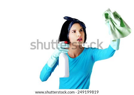 Portrait of happy woman with a cleaning fluid. - stock photo