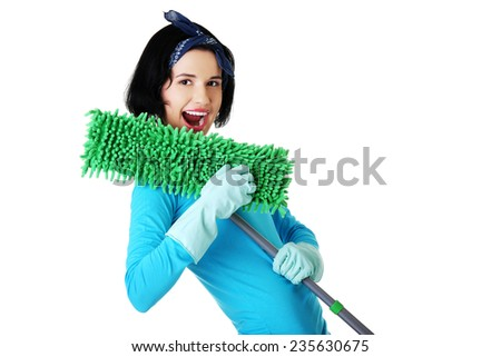 Portrait of happy woman with a mop. - stock photo