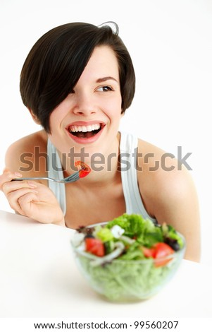 Portrait Of Happy Woman with bowl of salad, against on white background