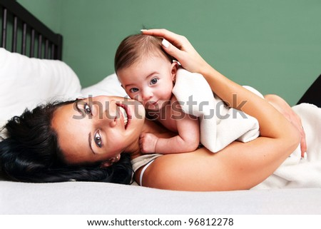 Portrait of happy woman with her baby - stock photo