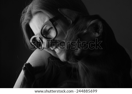 Portrait of happy woman with her cat - stock photo