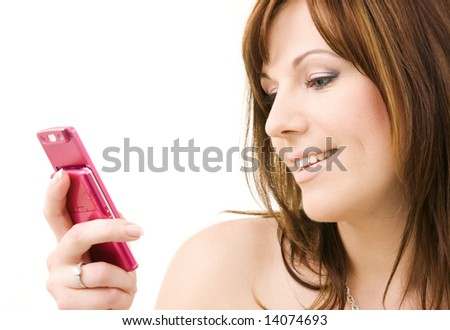 portrait of happy woman with pink phone - stock photo