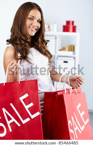 Portrait of happy woman with shopping bags - stock photo