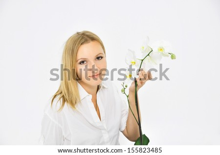 portrait of happy woman with white orchid - stock photo