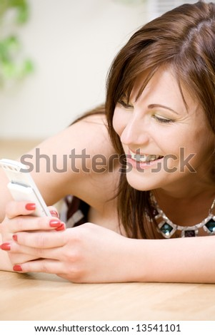 portrait of happy woman with white phone