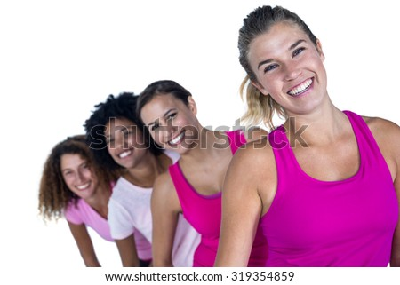 Portrait of happy women standing in row against white background