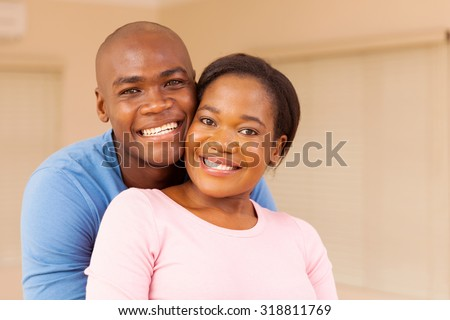 portrait of happy young african american couple indoors - stock photo