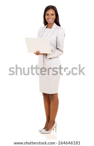 portrait of happy young african businesswoman with laptop - stock photo