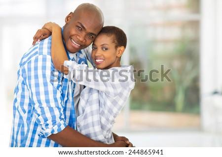 portrait of happy young african couple looking at the camera - stock photo