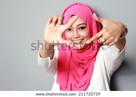 portrait of happy young attractive woman wearing scarf smiling to the camera - stock photo