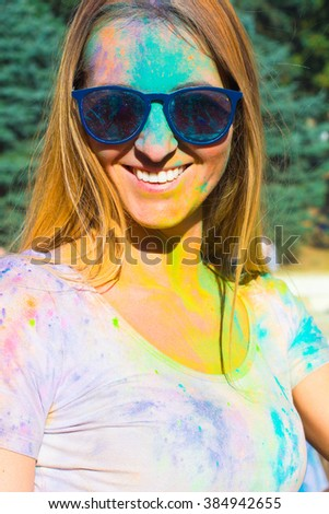 Portrait of happy young blondy girl on holi color festival