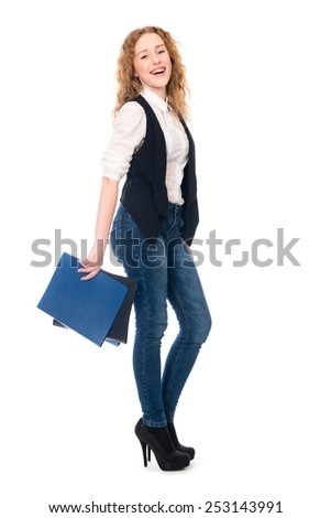 Portrait of happy young business woman. Cheerful secretary in full growth with folders. Isolated on white background. - stock photo