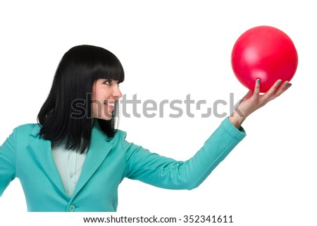 Portrait of happy young business woman holding a red ball isolated on white background - stock photo