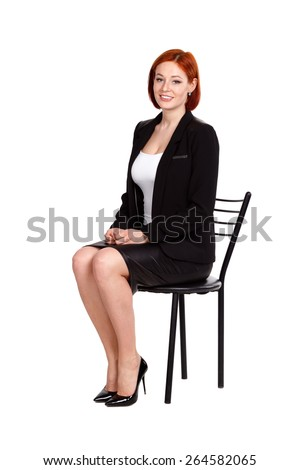Portrait of happy young business woman isolated on white background - stock photo