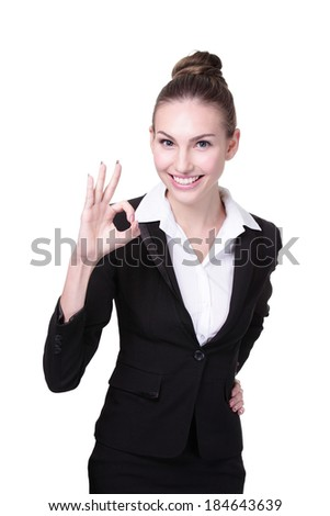 Portrait of happy young business woman show ok hand gesture isolated on white background - stock photo