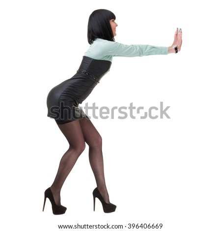 Portrait of happy young business woman with holding gesture - stock photo