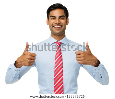 Portrait of happy young businessman gesturing thumbs up over white background. Horizontal shot. - stock photo